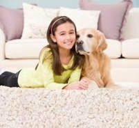 girl and her dog on carpet